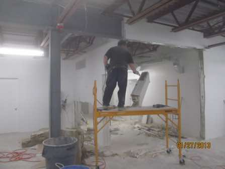 "The demolition of the drywall partitions proved difficult as they were 6"" thick, insulated and double sheeated with drywall sheeting. The easiest method was to cut the walls apart in chunks with reciprocating saws."